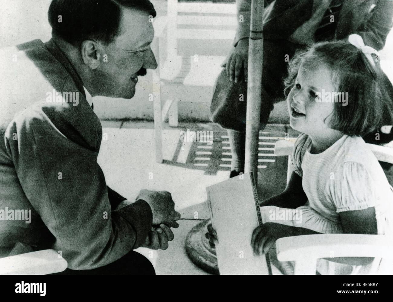 Adolf Hitler talking with a girl, historical photo circa 1937 - Stock Image