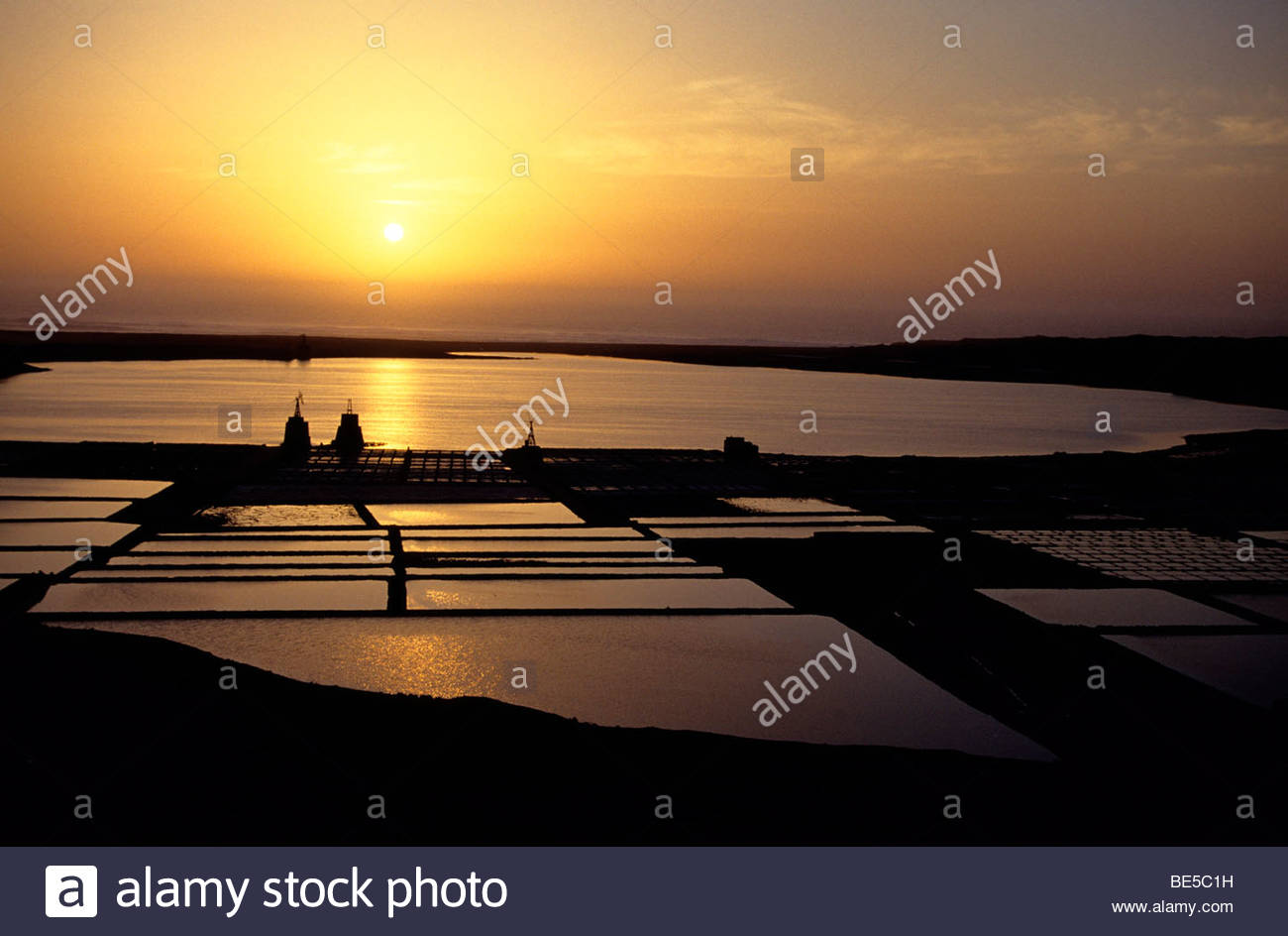 Spain, Canary Islands - Sunset over a salt basin, Salinas De Janubio, Lanzarote Stock Photo