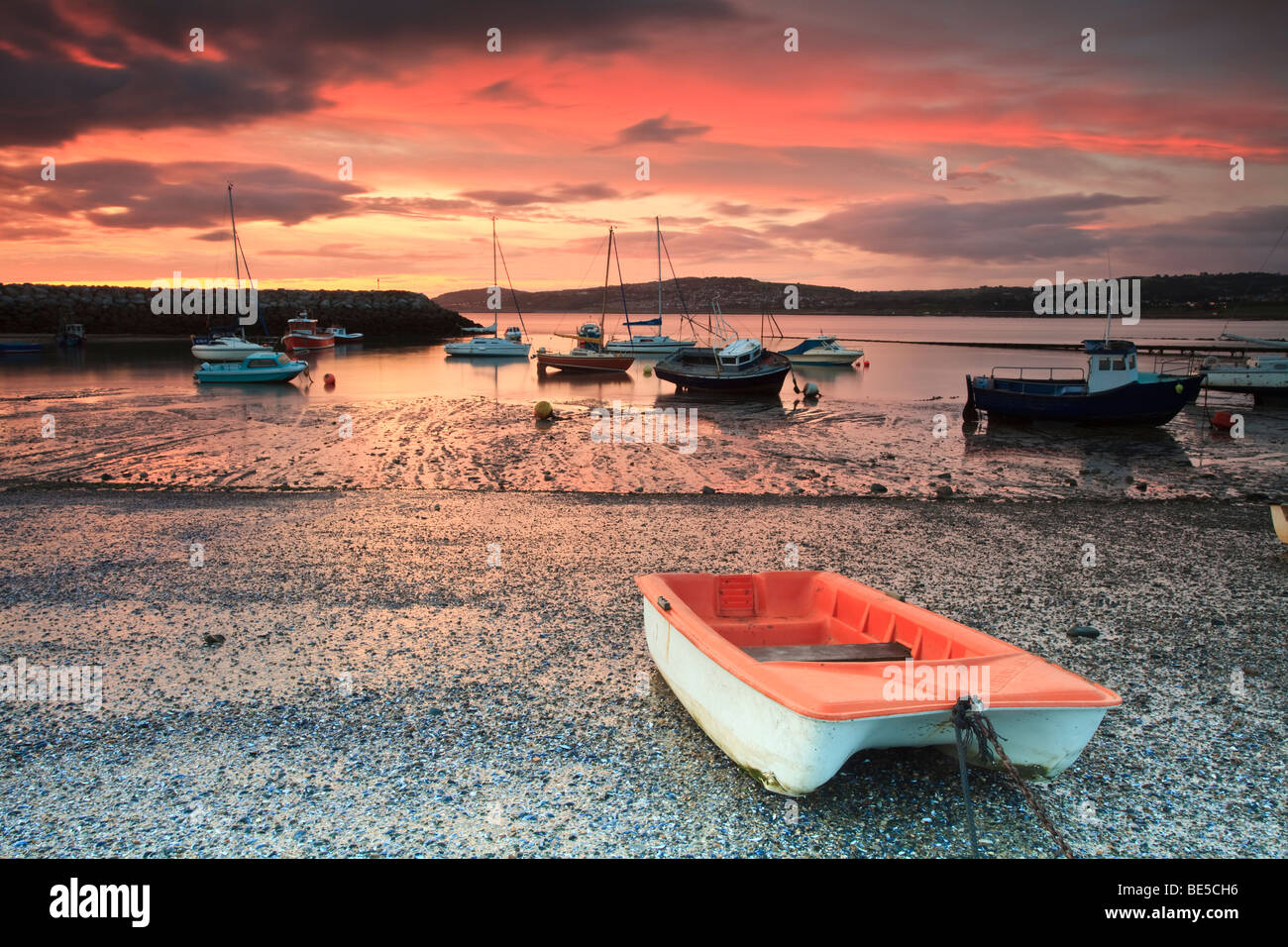 Early morning in Rhos harbour with the boats waiting for the tide in Rhos on Sea, Colwyn Bay, Wales, UK - Stock Image