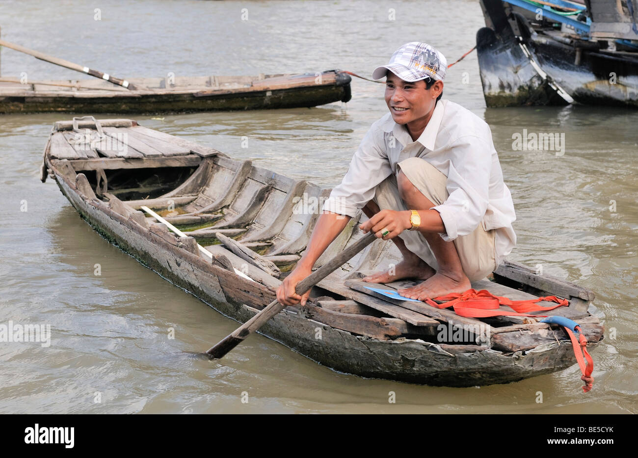 Man with a small rowboat, Mekong Delta, Vietnam, Asia - Stock Image