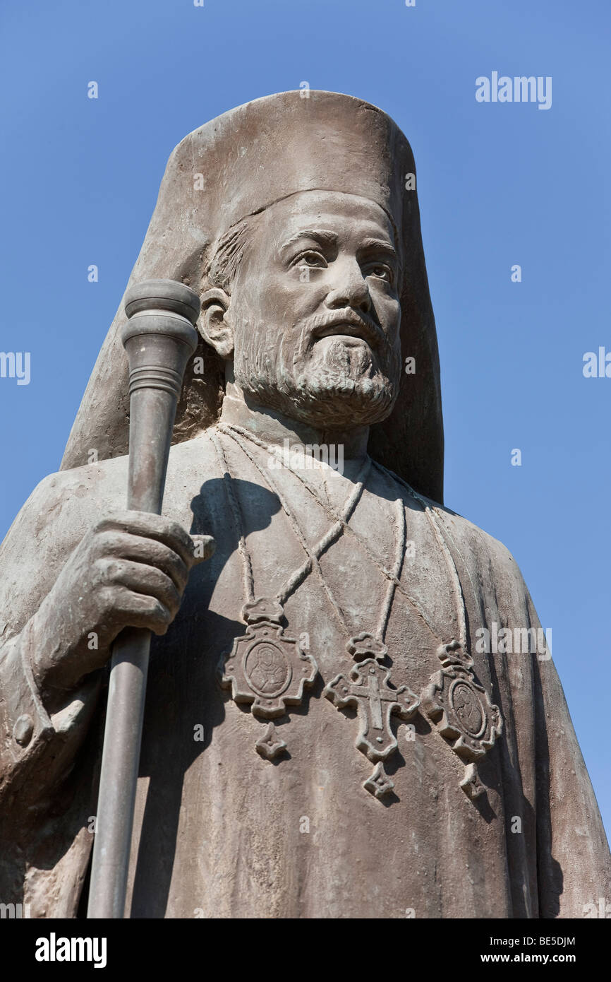 Statue in front of the modern Church of St. George, Agios Georgios, Larnaca, Southern Cyprus, Cyprus, Europe - Stock Image