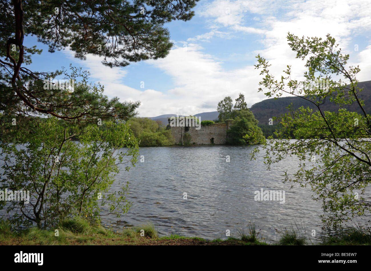 An island with ruined castle in Loch an Eilein near Aviemore, Inverness-shire, Scotland, United Kingdom. - Stock Image