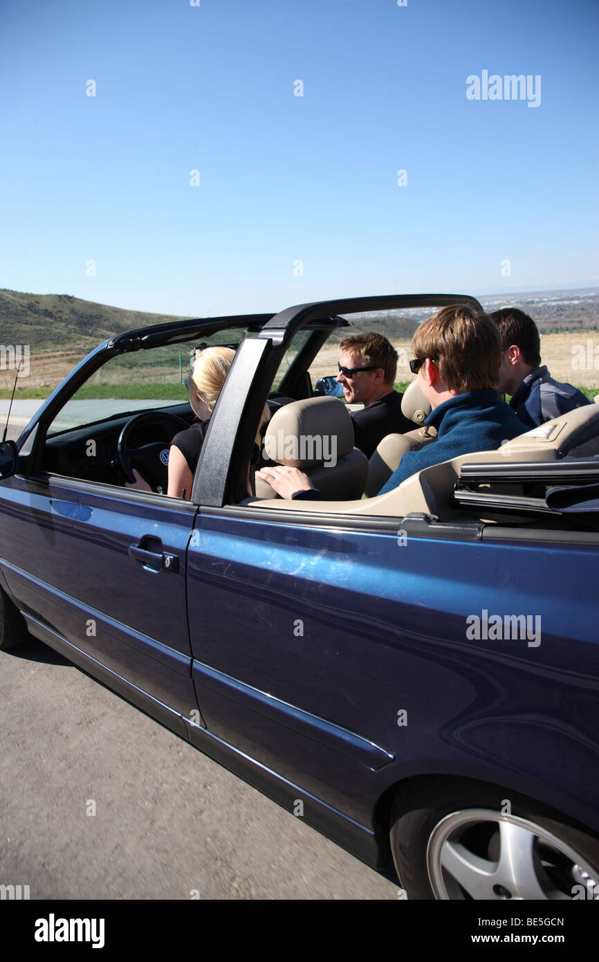 Group of young people in convertible car - Stock Image
