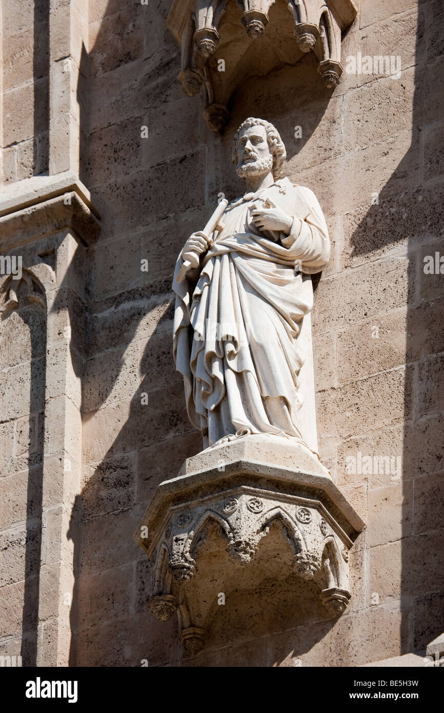 Statue of learned man on face of Palma cathedral La Seu Cathedral Palma Mallorca Spain - Stock Image