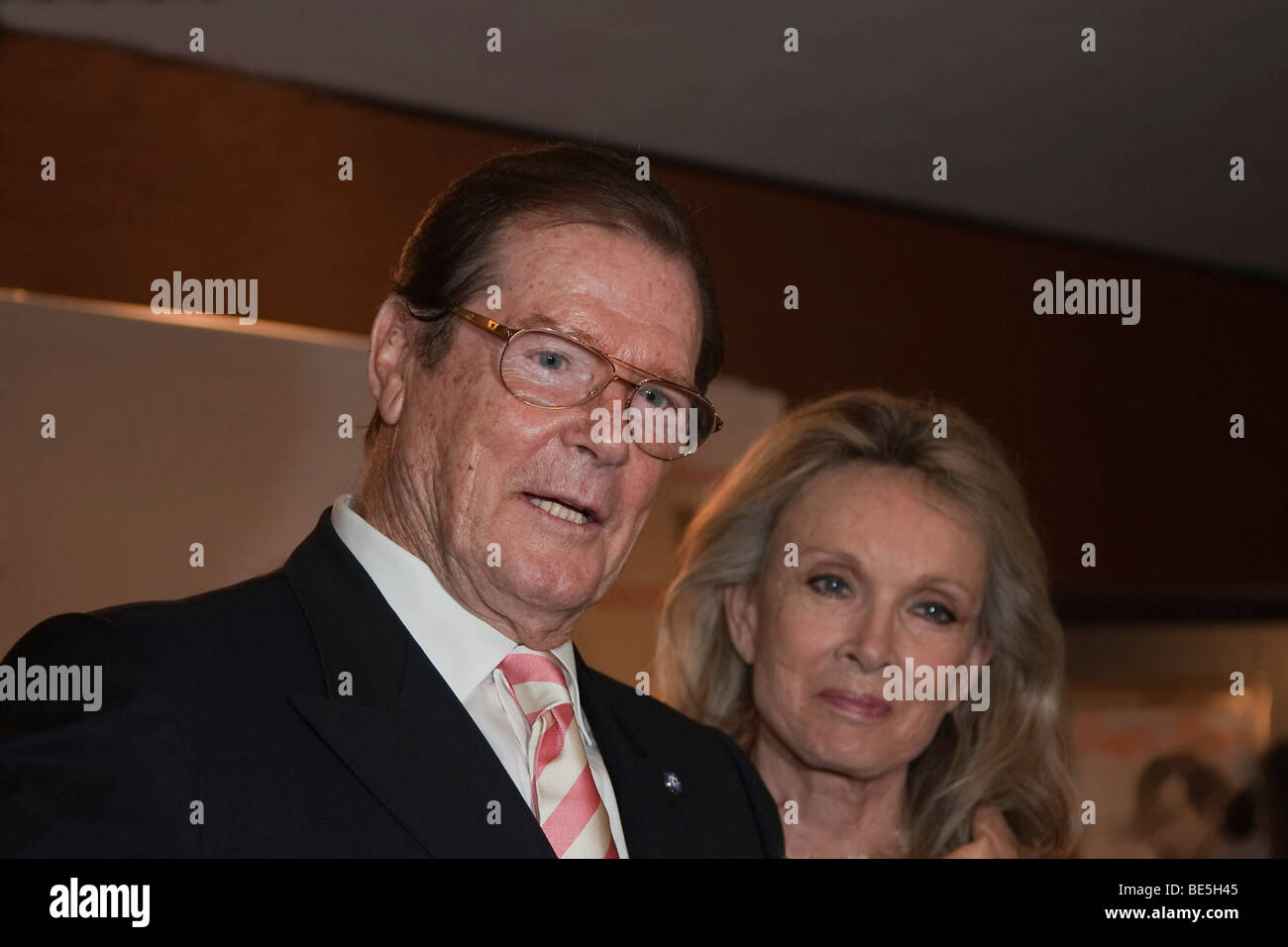 The English actor and former James Bond actor Sir Roger Moore with his wife Lady Kristina Tholstrup Stock Photo