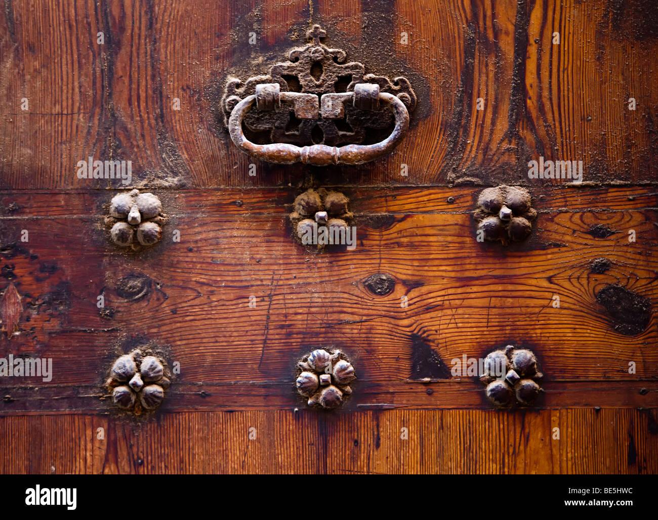 Metal Door Knocker On Old And Yellowing Pine Door Palma Mallorca Spain    Stock Image