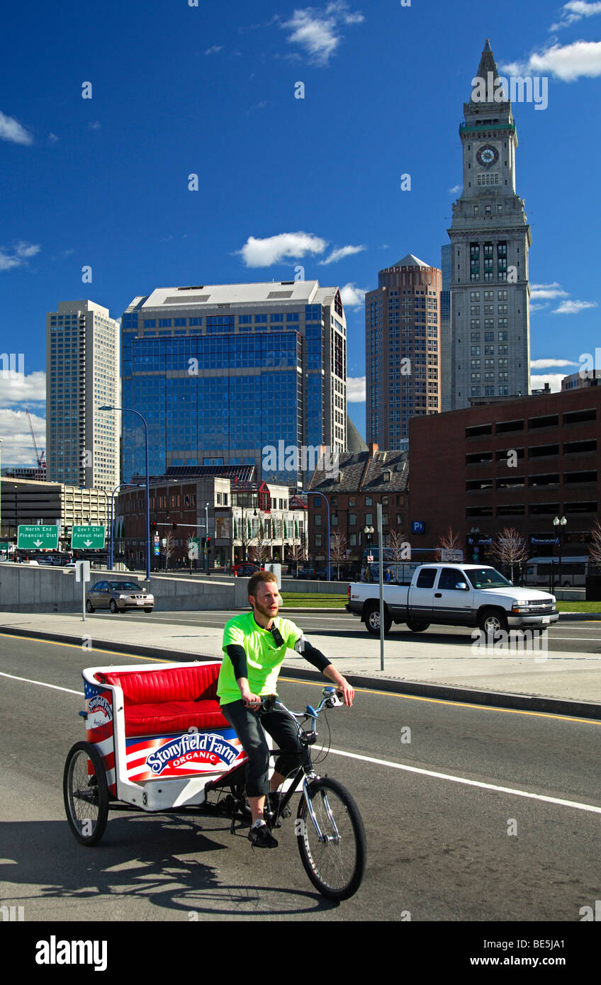 Bicycle rickshaw driver looking for clients in down-town Boston, Massachusetts, USA - Stock Image