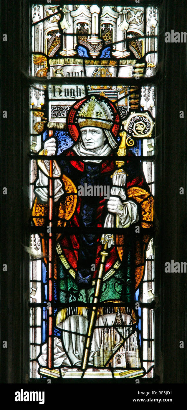 A Stained Glass Window Depicting Saint Hugh of Lincoln, Welbourn Church, Lincolnshire - Stock Image