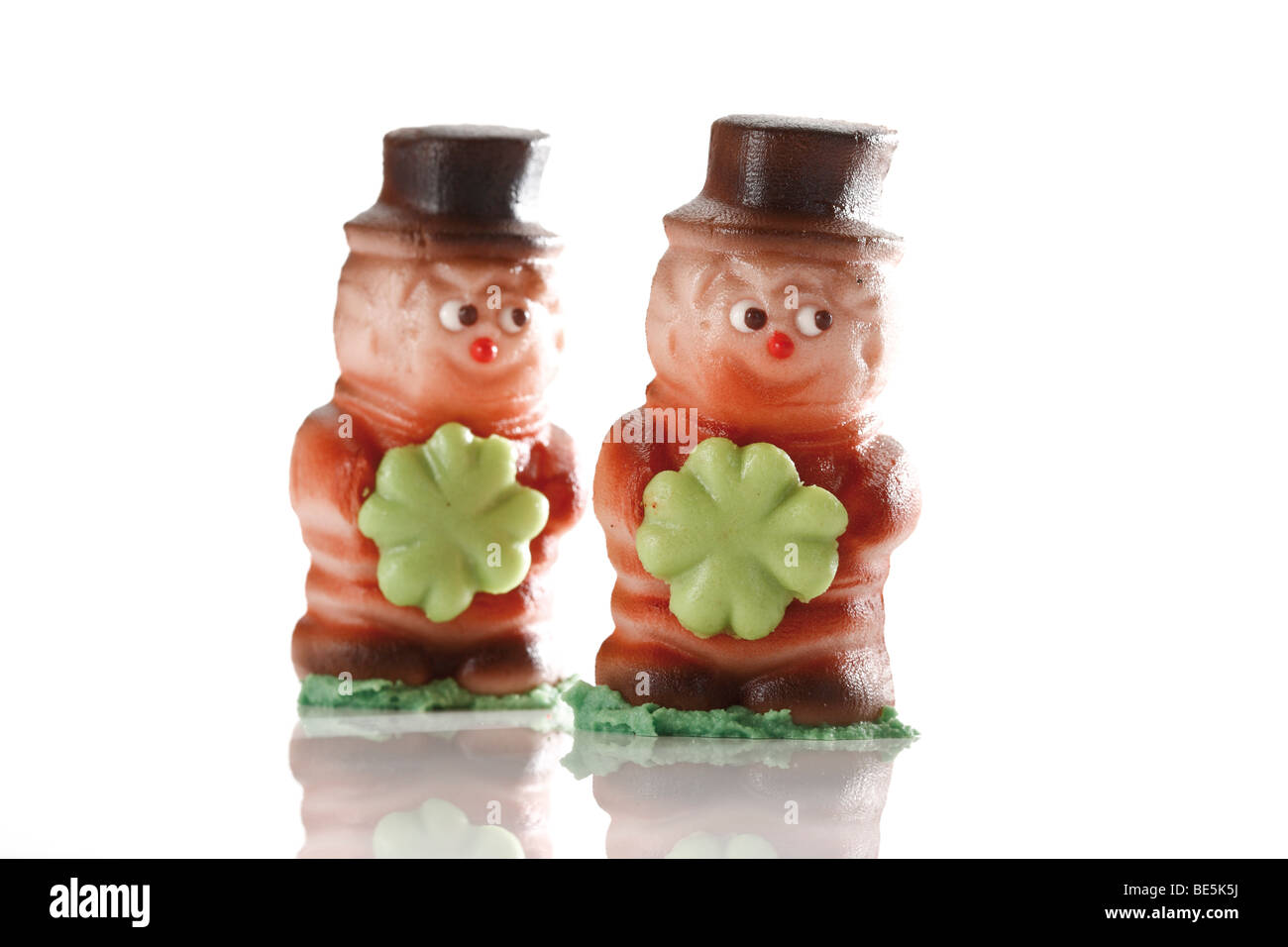 Two small chimney sweepers, made of marzipan - Stock Image