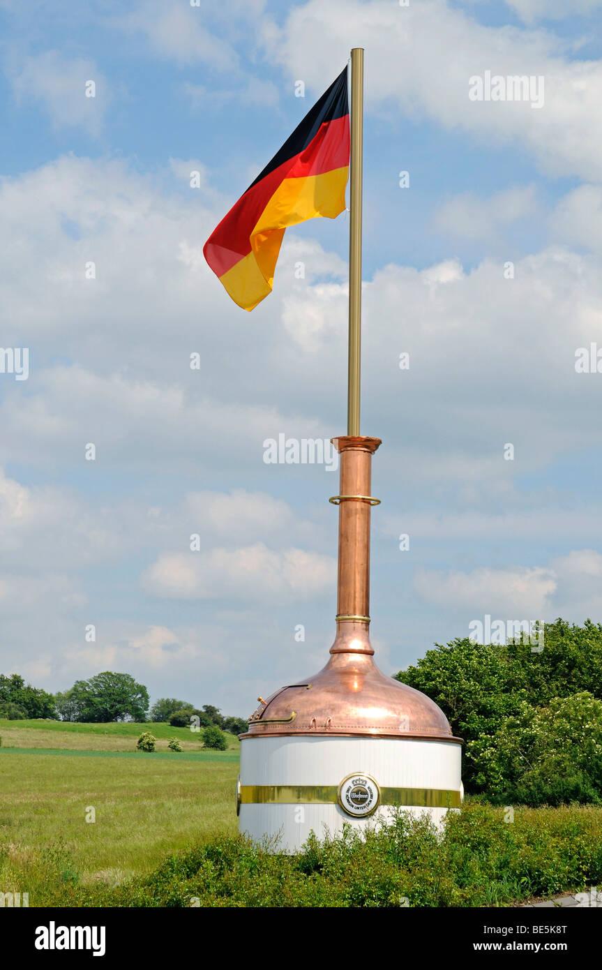 German flag, in copper vat, Warsteiner Brauerei brewery, visitor center, Warstein, Soest, Sauerland, North Rhine - Stock Image