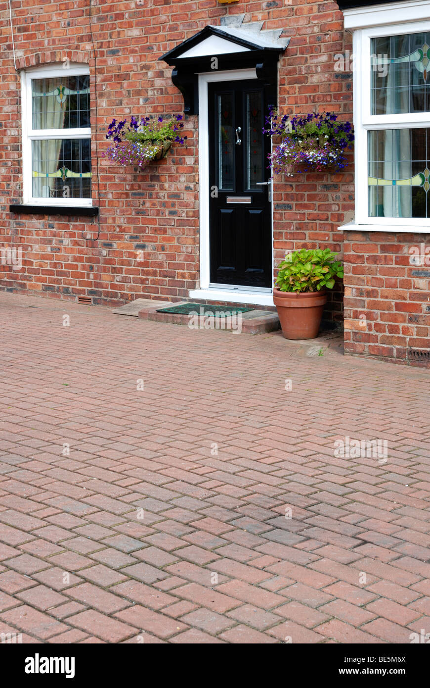 a front garden with modern block paving, uk - Stock Image