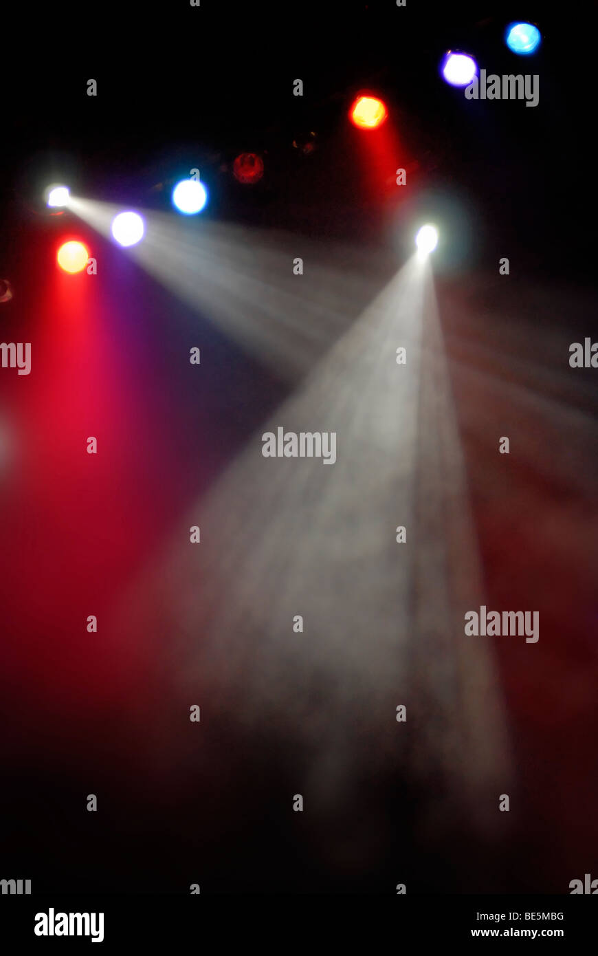 Red, white and blue stage lights; concert  or theater background. - Stock Image