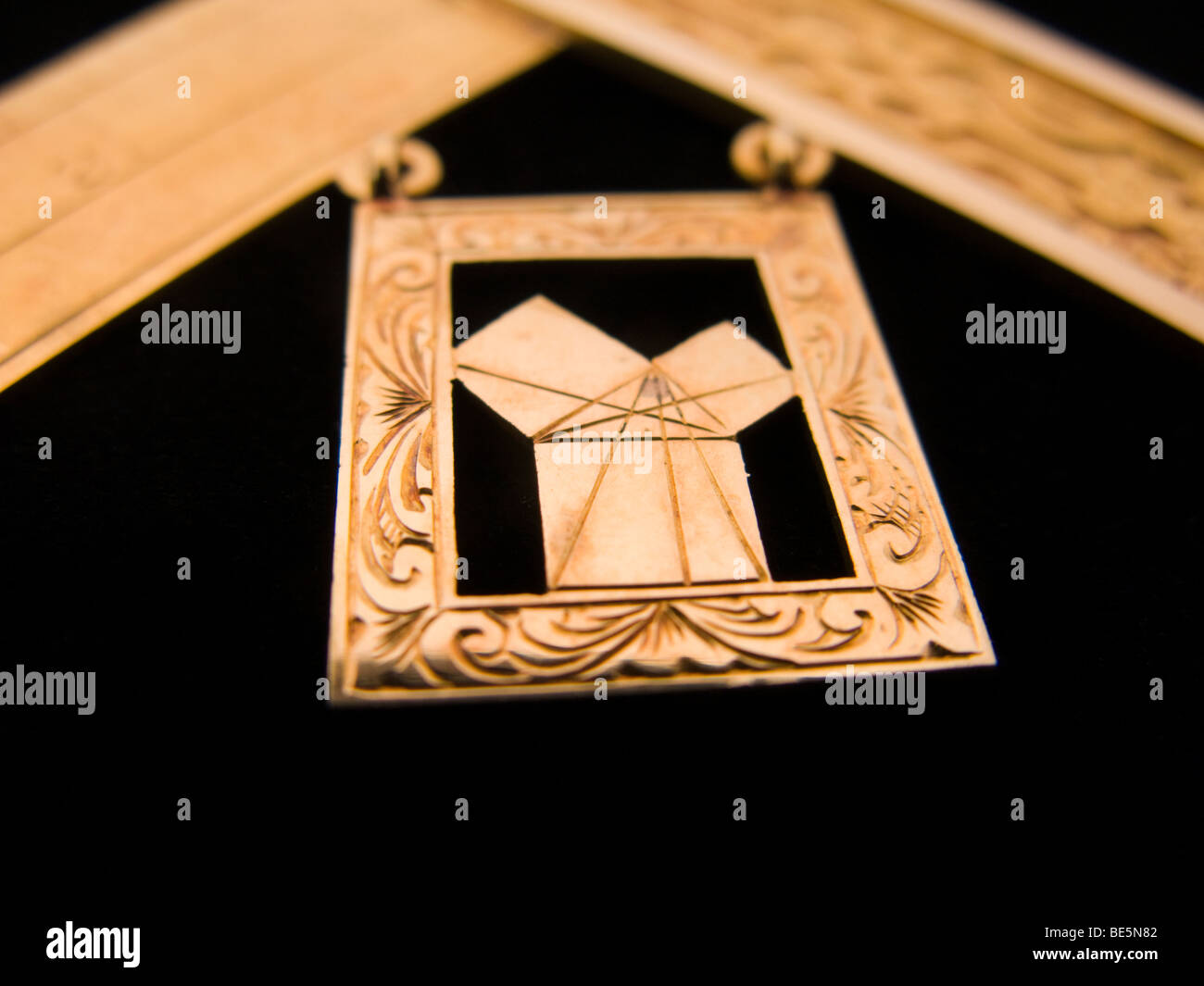 Pythagorean Theorem symbolised with a diagram engraved on a masonic Past Master medal jewel, in gold. - Stock Image