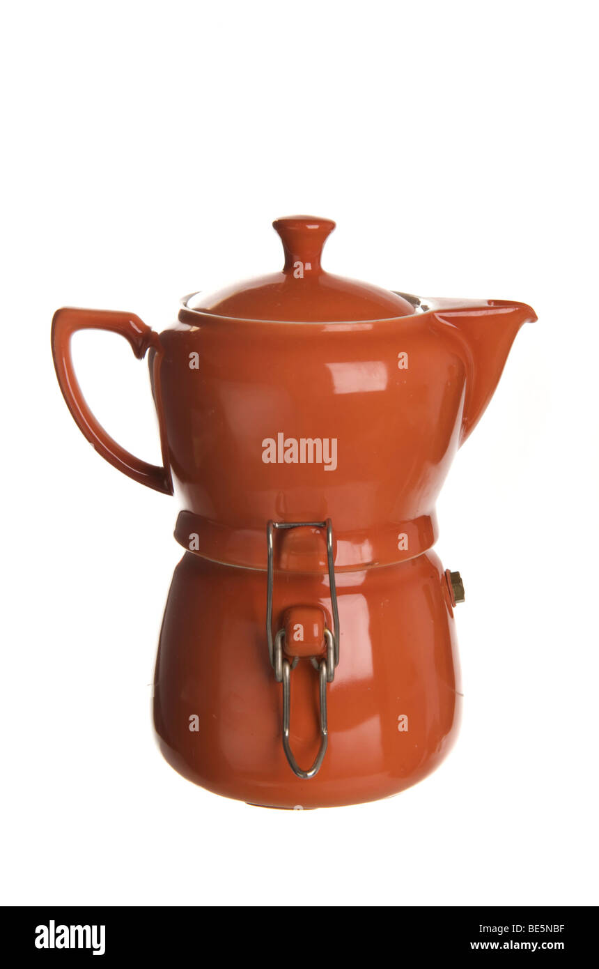 Old espresso pot for the stove, made of terracotta-coloured ceramic - Stock Image