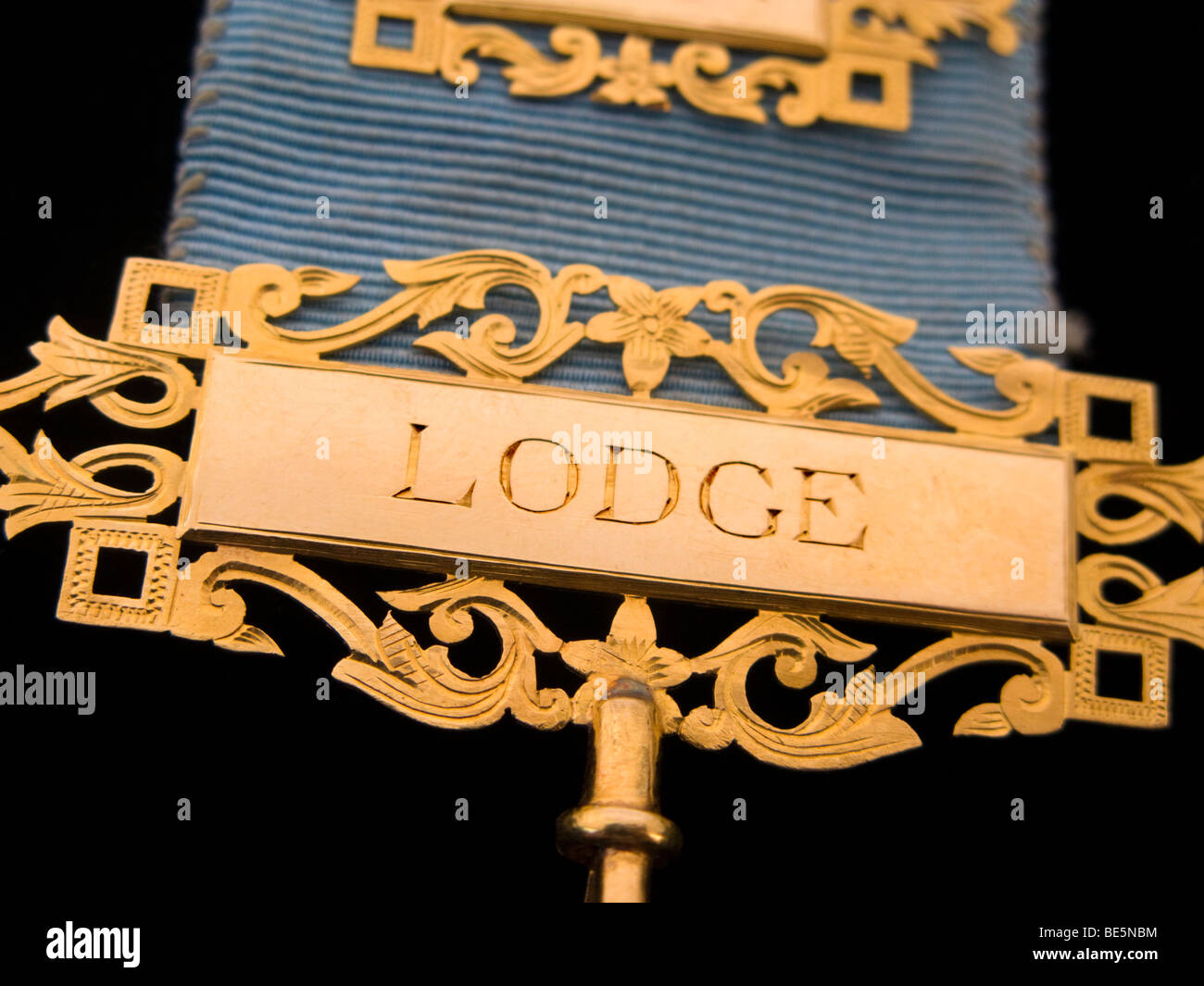 Lodge engraving on a Masonic Past Master Medal's bar, in 18 carat