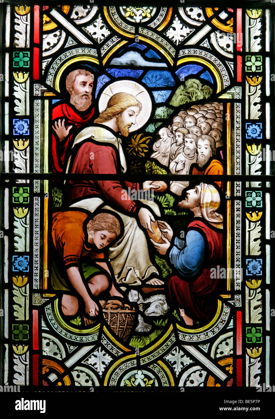 Stained Glass Window Depicting The Feeding of the Five Thousand, St John the Baptist Church, South Carlton, Lincolnshire Stock Photo