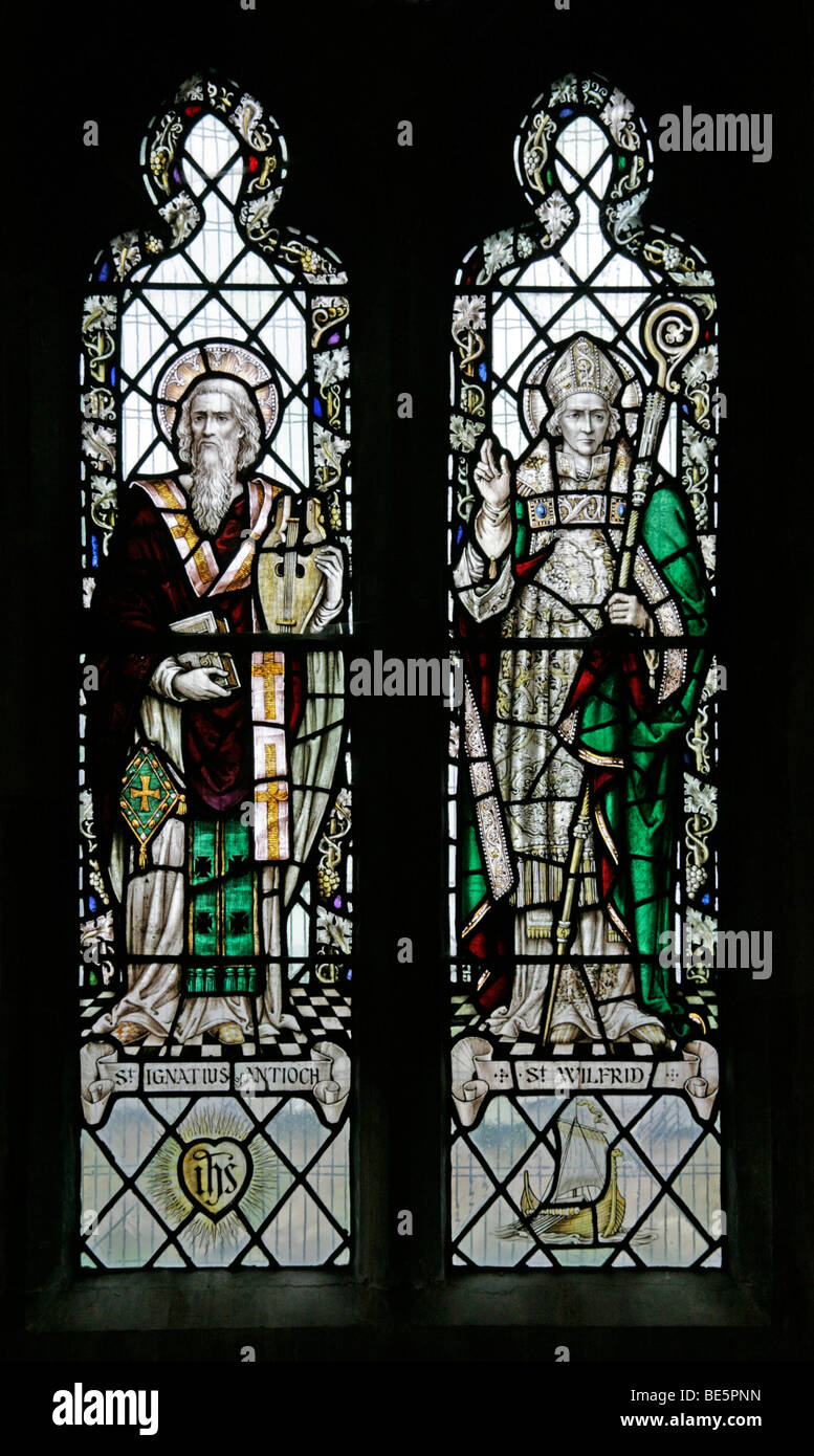 Stained Glass Window Depicting Saints Wilfrid and Ignatius of Antioch, St Wilfred's Church Metheringham - Stock Image