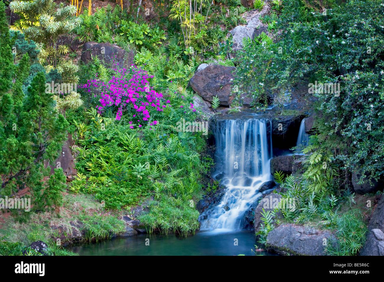 Waterfall At Na Aina Kai Botanical Gardens. Kauai, Hawaii