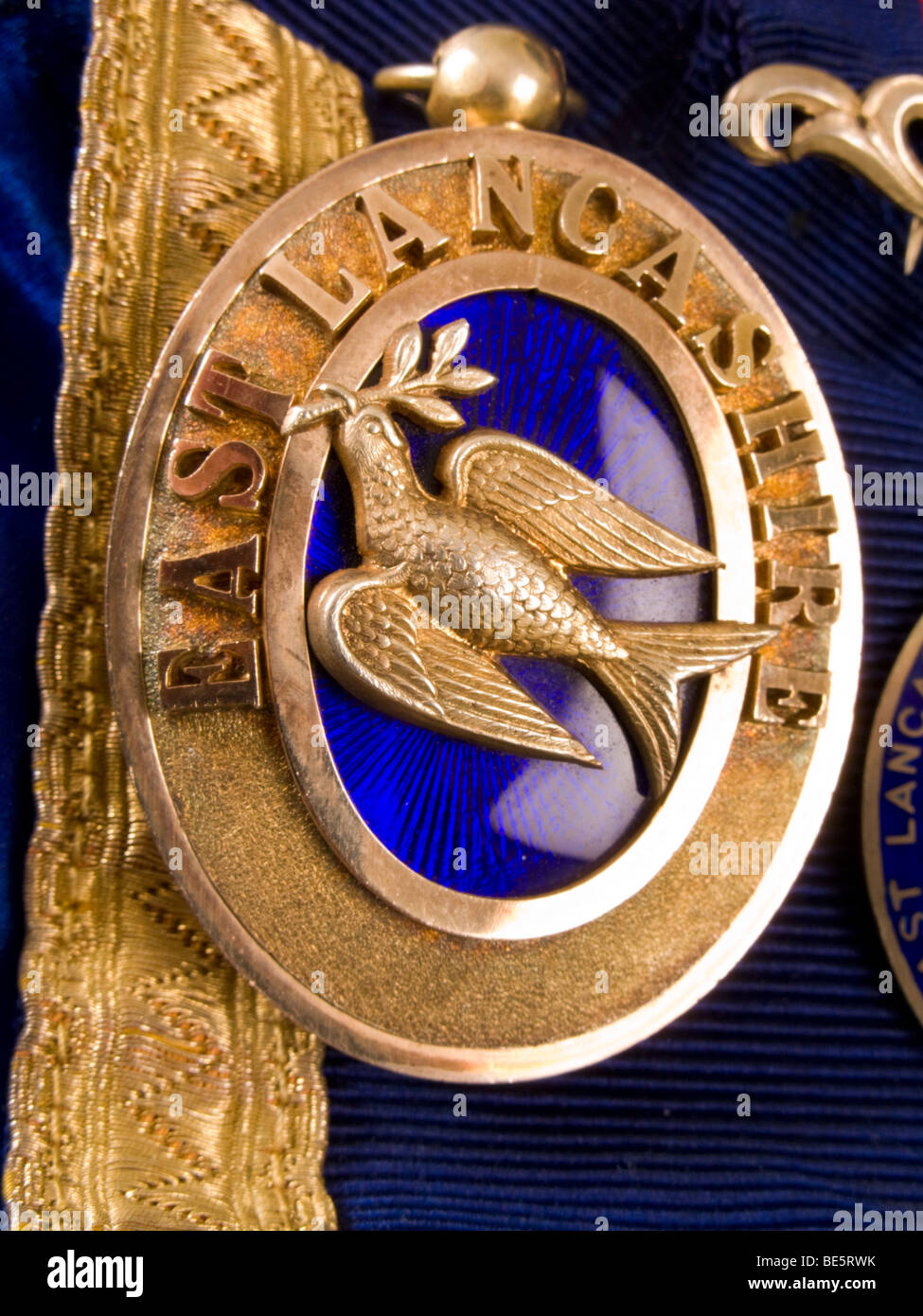 Deacon Jewel (Masonic Deacon medal / jewel) depicting a dove with acacia leaf / olive branch in its beak. - Stock Image