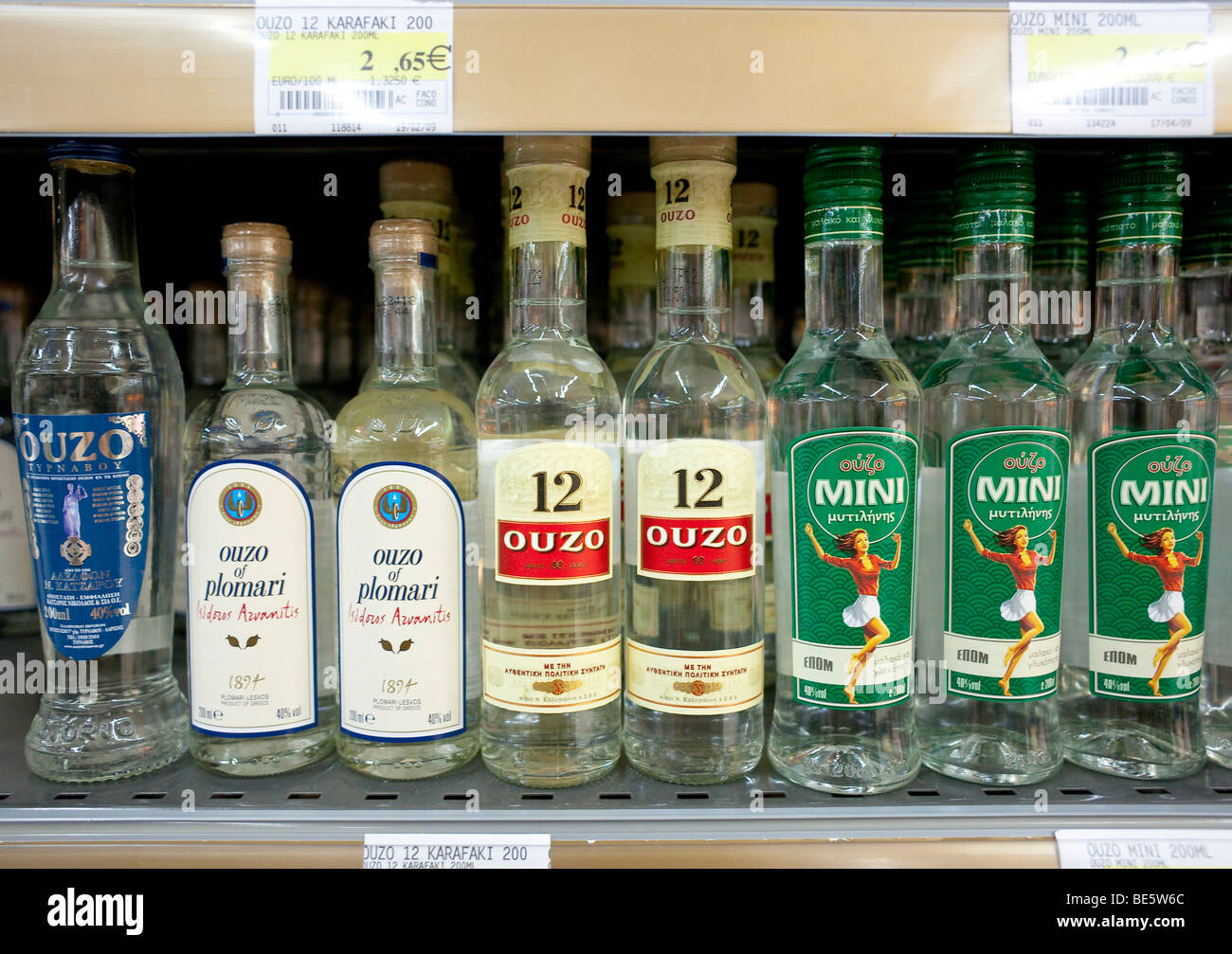 Different brands of Ouzo on a shelf in a Cypriot supermarket, Cyprus, Europe - Stock Image