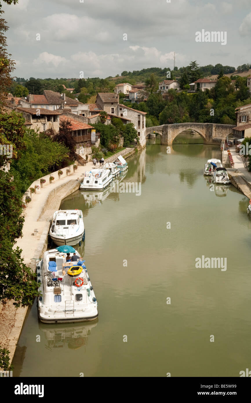 Boats moored on the River Lot at Nerac, Aquitaine France Stock Photo