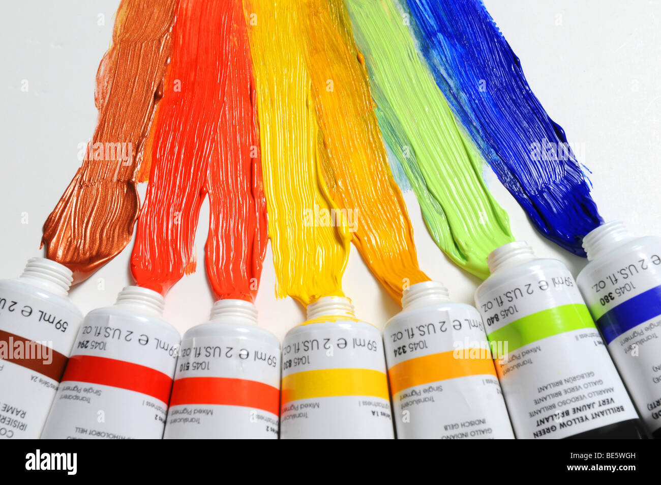 Paint of different colors spread over a white background Stock Photo