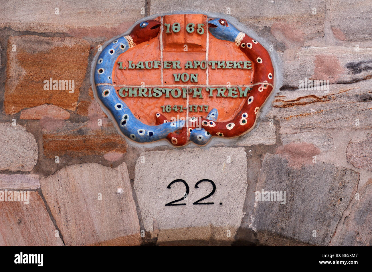 Old pharmacy sign from 1665 at a house wall, Lauf an der Pegnitz, Middle Franconia, Bavaria, Germany, Europe - Stock Image