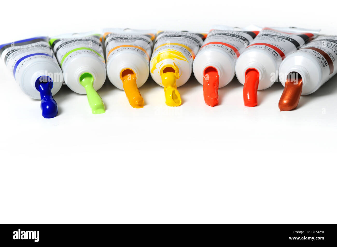 Multicolor tubes of paint over a white background Stock Photo