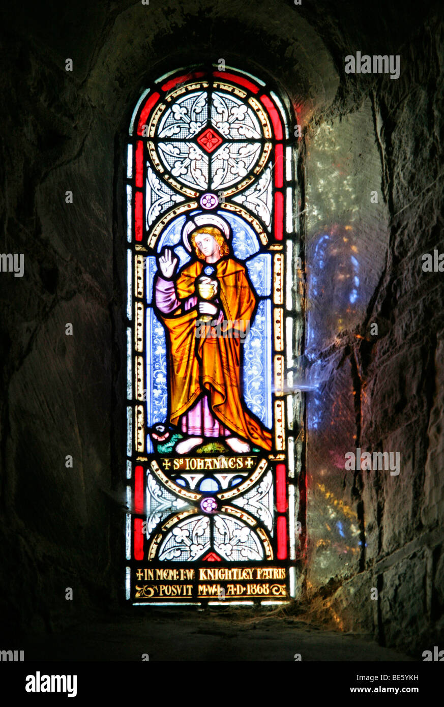 A Stained Glass Window Depicting Saint John, St Gregory's Church, Offchurch, Warwickshire: Window is by William - Stock Image