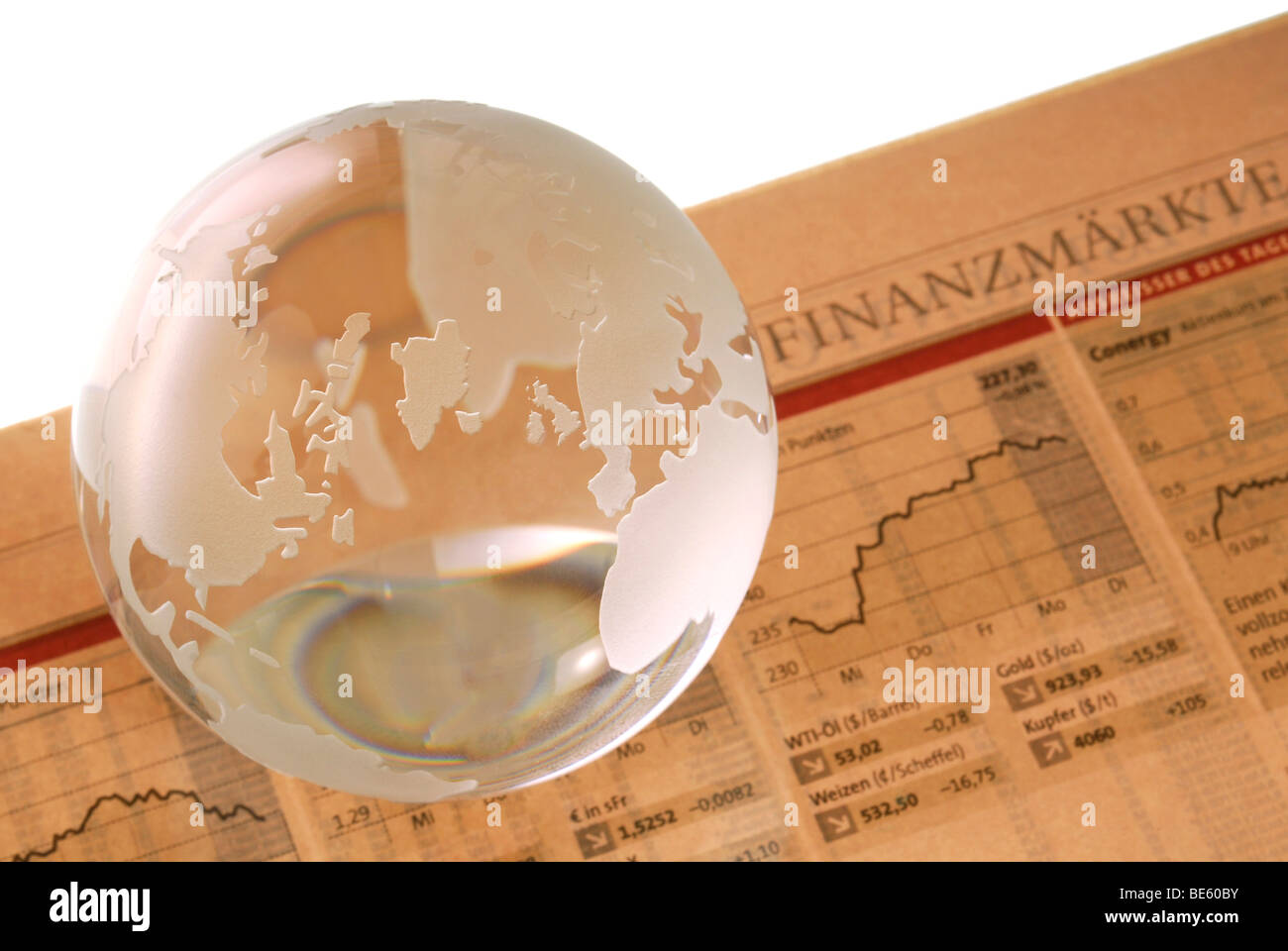 Globe on financial newspaper, financial market Stock Photo