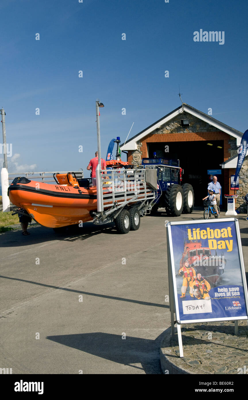 Visitors looking over the lifeboat station at Skerries, county Dublin, Ireland on Lifeboat Day - Stock Image