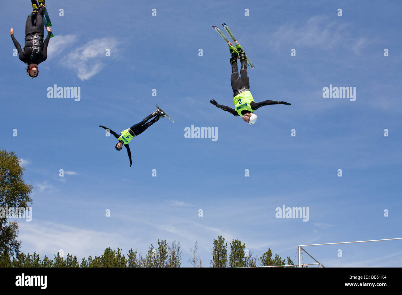 Three Freestylers in Freefall. During a summer demonstration three young Olympic freestyle skiing hopefuls fill - Stock Image