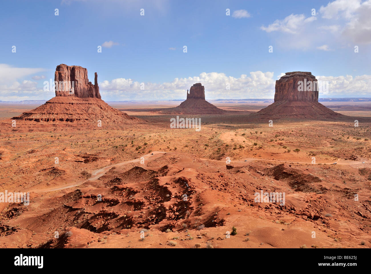 West Mitten Butte, Eastern Mitten Butte and Merrick Butte, from left to right, multi-layered red sandstone, Monument - Stock Image