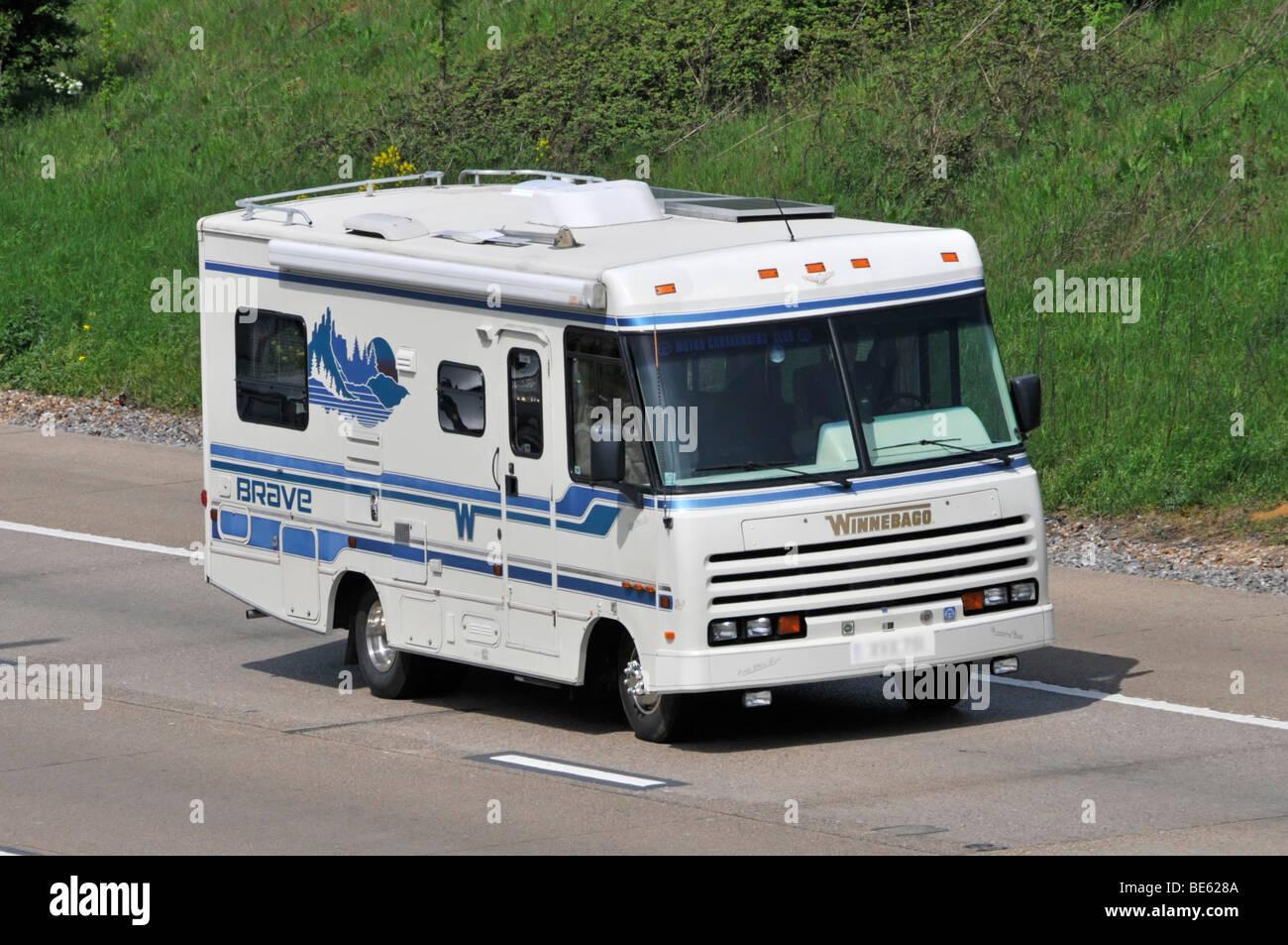 American Winnebago Brave RV recreational vehicle motorhome camper van driving along M25 UK motorway obscured numberplate Stock Photo