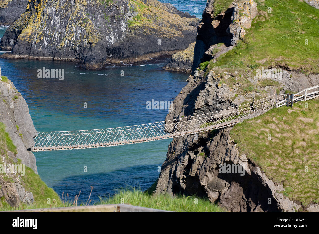 Empty Rope Bridge. A rare moment when no one is crossing the the famous rope bridge over the bright blue and green - Stock Image