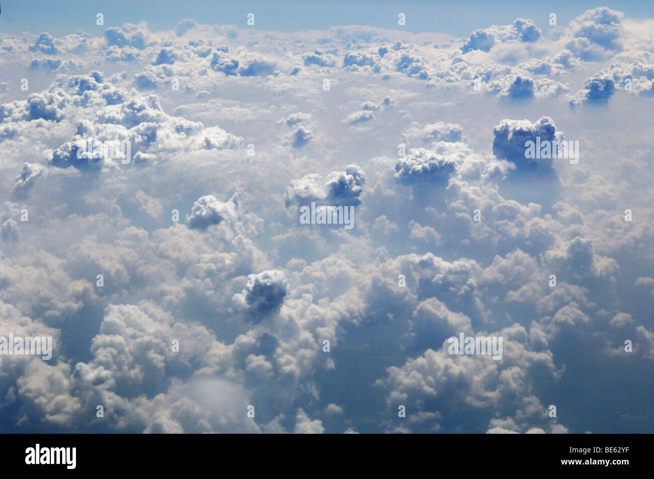 White cumulus clouds - Stock Image