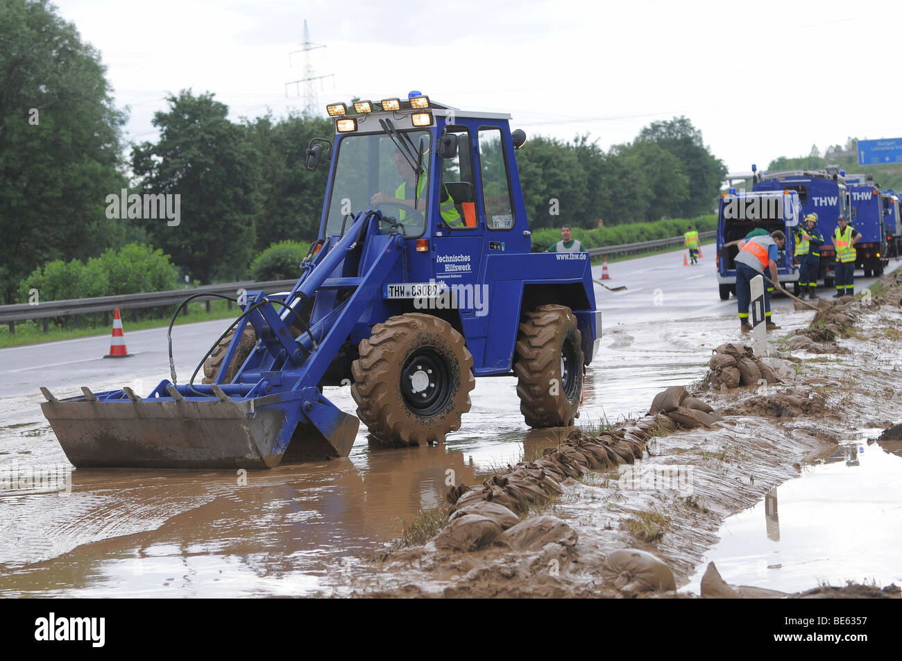 THW, Federal Agency for Technical Relief, and the fire brigade clearing mud from a flooded highway, A 81 at km 563, - Stock Image
