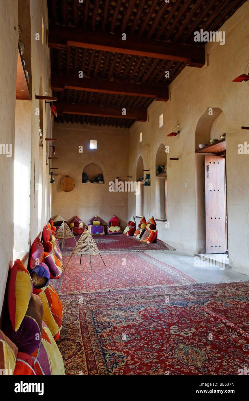 Traditional Arabian living room at the historic adobe fortification Nakhal, Nakhl Fort or Castle, Hajar al Gharbi Stock Photo