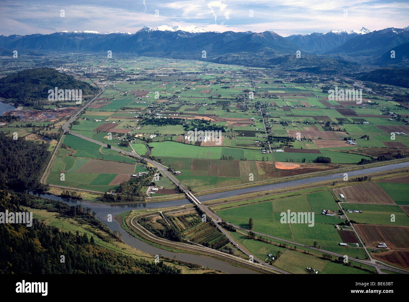Scenic Aerial View, Farmland in Fraser Valley, and Cascade Mountains near Chilliwack, BC, British Columbia, Canada - Stock Image