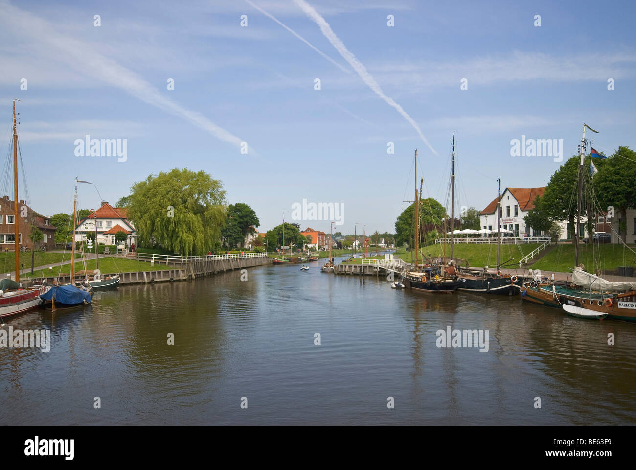 Old Port, Museum Port of Carolinensiel, historic flat-bottomed sailing ships in the port, view over the Harle River - Stock Image