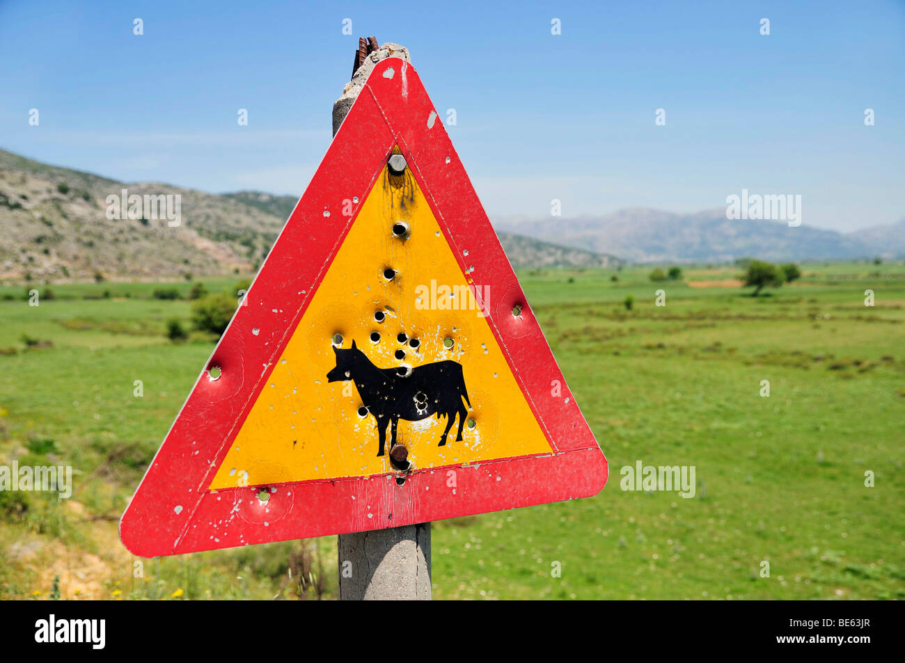 Traffic sign with bullet holes on the Lassithi Plateau, Eastern Crete, Crete, Greece, Europe - Stock Image