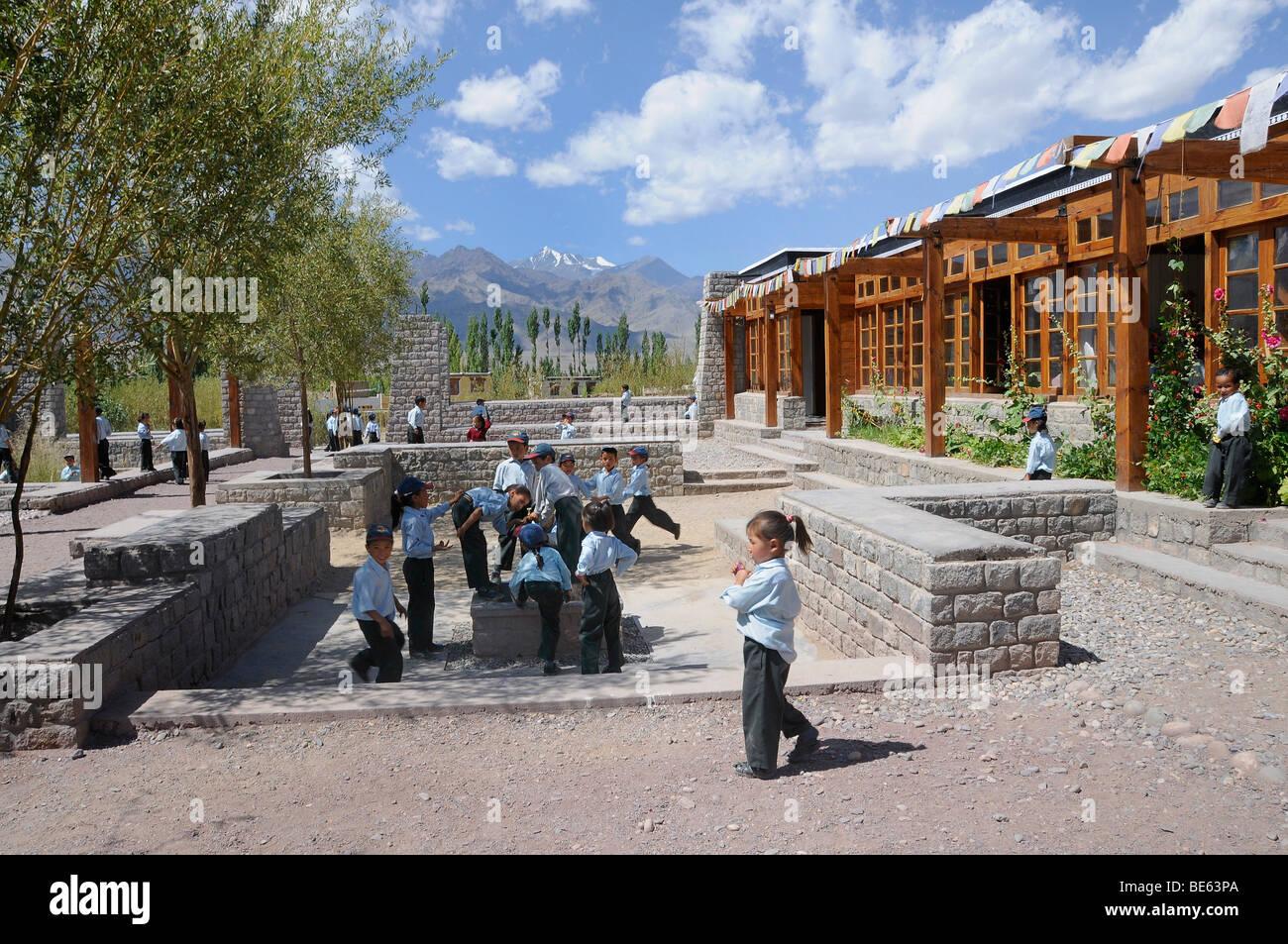 Elementary school children in the modern playground of the private-religious Druk White Lotus School, Shey, Ladakh, - Stock Image
