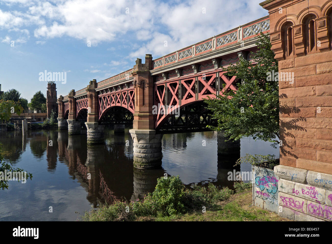 Railway bridge across River Clyde in central Glasgow Scotland seen from north-east. - Stock Image