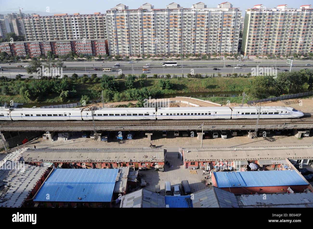 A CRH (China Railway High-speed) bullet train through Beijing city. 21-Sep-2009 - Stock Image