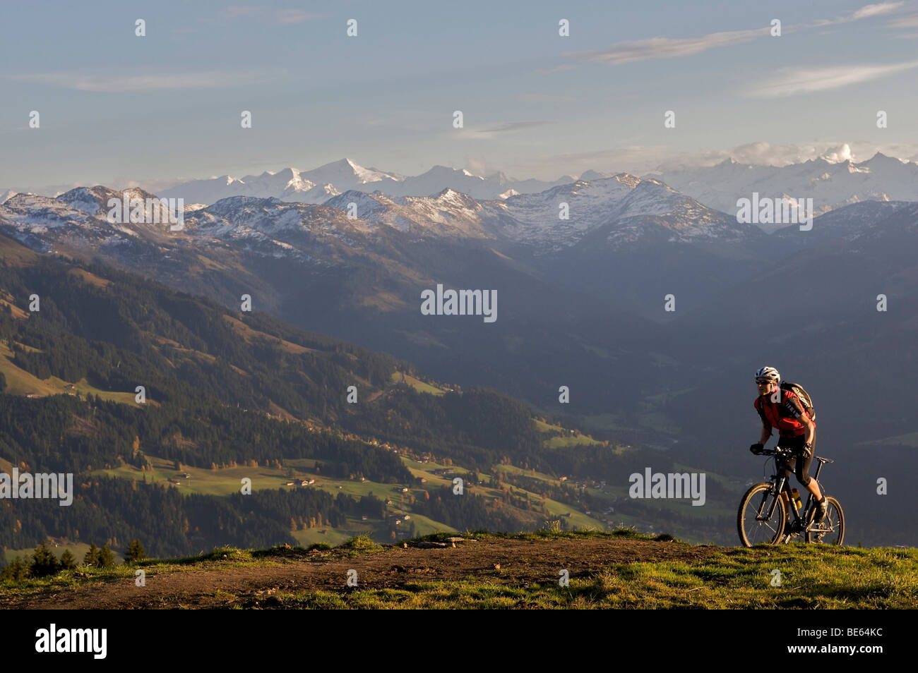 Mountainbiker at Hohe Salve mountain, the Grossvenediger mountain in the back, Tyrol, Austria, Europe Stock Photo