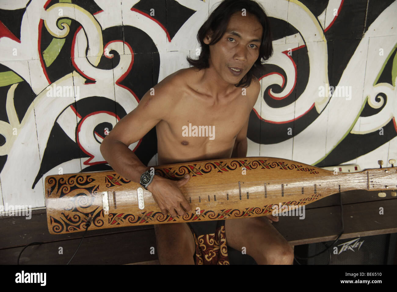 Iban musician playing a traditional instrument, in the Sarawak Cultural Village near Kuching, Sarawak, Borneo, Malaysia, - Stock Image