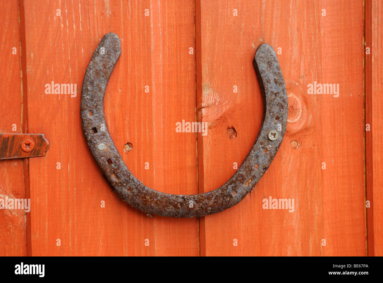 Lucky Horseshoe Fixed to a Shed Door - Stock Image
