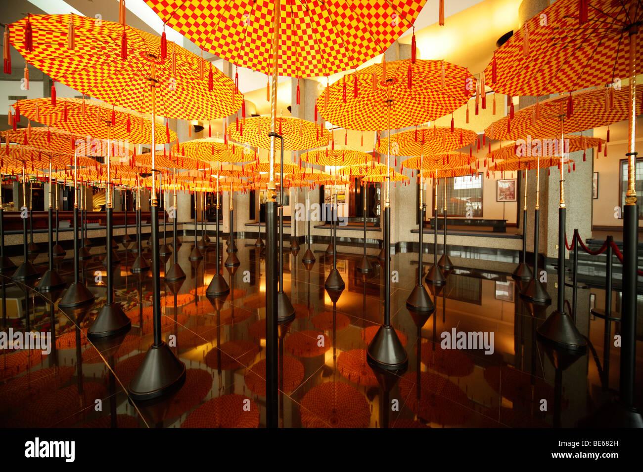 Umbrellas in the Royal Treasury, Royal Regalia Museum in the capital city, Bandar Seri Begawan, Brunei, Asia - Stock Image