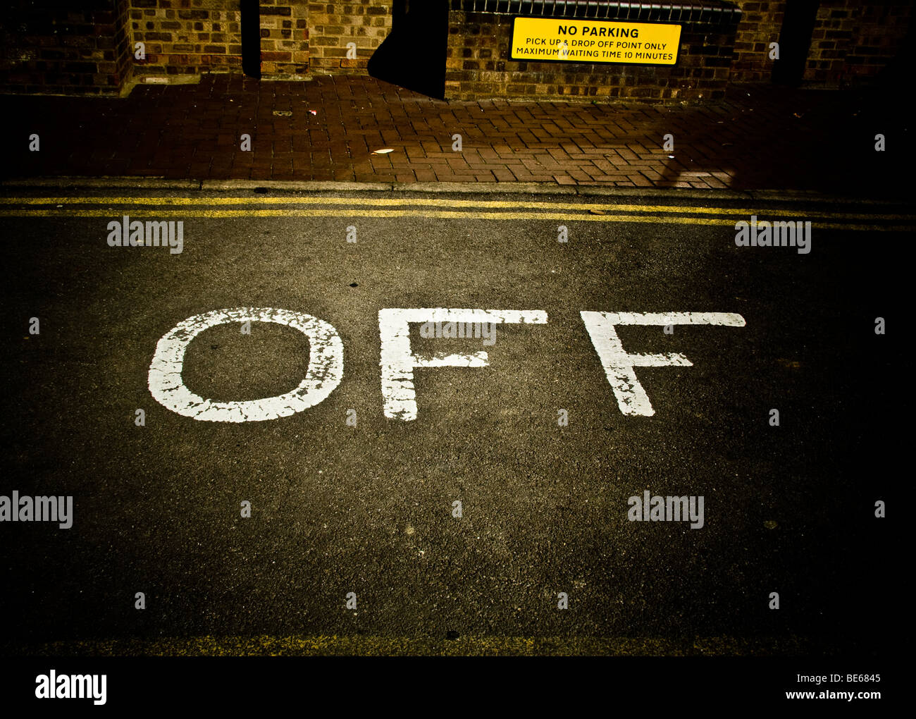 off  written in paint on the road. - Stock Image