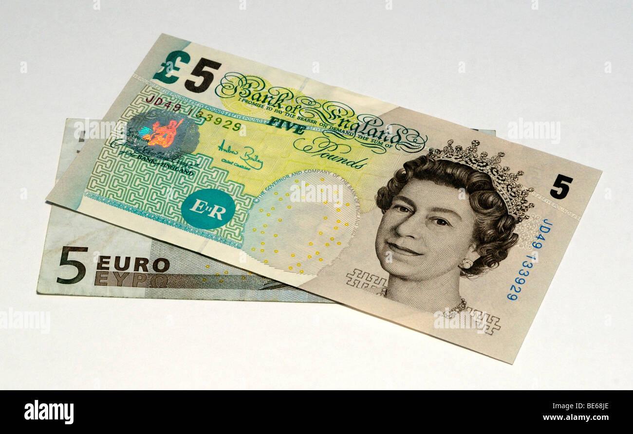 Euro and United Kingdom Pound Bank Notes. Stock Photo
